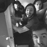 Ben (crouched over in pain), Pete (smiling, delirious), Steve (naked) and Jeremy (too close to the camera for his own good.)